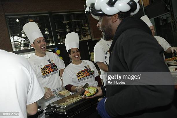 Head coach of the Indiana Pacers Frank Vogel and his wife Jen serve up a dish as part of the Pacers 'Come to Our House' Thanksgiving Diner at Conseco...