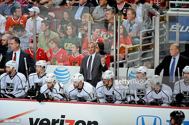 Head coach of the Los Angeles Kings Darryl Sutter coaches the Kings in between assistant coaches John Stevens and Davis Payne in Game One of the...