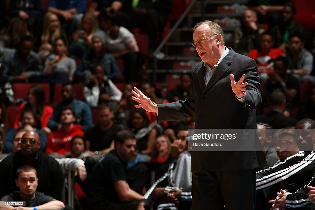 Head Coach of the Minnesota Timberwolves <a gi-track='captionPersonalityLinkClicked' href=/galleries/search?phrase=Rick+Adelman&family=editorial&specificpeople=209189 ng-click='$event.stopPropagation()'>Rick Adelman</a> gestures to an official as his team faces the Boston Celtics during their NBA pre-season game at the Bell Centre on October 20, 2013 in Montreal, Quebec, Canada.