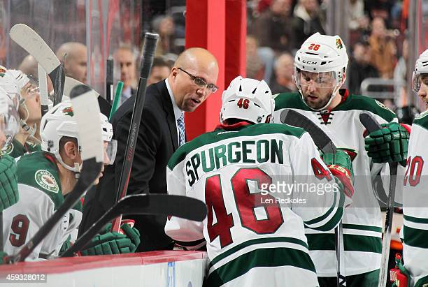 Head Coach of the Minnesota Wild Mike Yeo speaks to his team during a timeout against the Philadelphia Flyers on November 20 2014 at the Wells Fargo...
