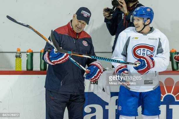 Head coach of the Montreal Canadiens Claude Julien and Brendan Gallagher compare sticks during the Montreal Canadiens practice session at the Bell...