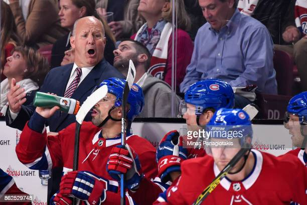 Head coach of the Montreal Canadiens Claude Julien yells out instructions to his players against the Toronto Maple Leafs during the NHL game at the...