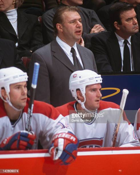 Head Coach of the Montreal Canadiens Michel Therrien follows the action from the bench during a game at the Molson Centre circa 2001 in Montreal...