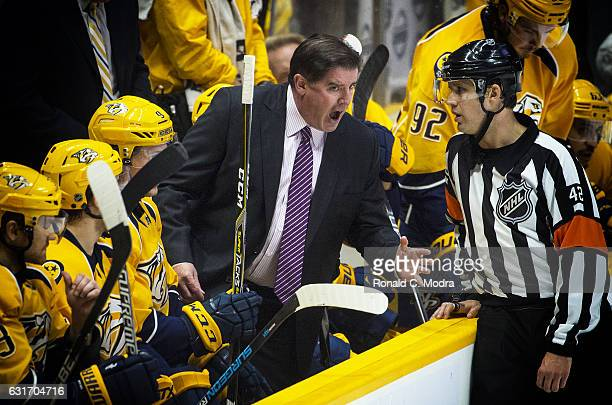 Head coach of the Nashville Predators reacts during a NHL game against the Minnesota Wild at Bridgestone Arena on December 27 2016 in Nashville...