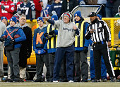 Head coach of the New England Patriots Bill Belichick yells from the sidelines in the first quarter against the Green Bay Packers during the NFL game...