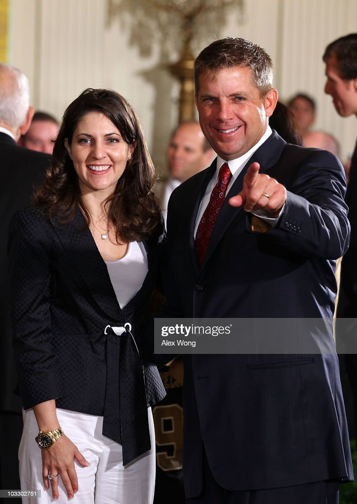 Head coach of the New Orleans Saints <a gi-track='captionPersonalityLinkClicked' href=/galleries/search?phrase=Sean+Payton&family=editorial&specificpeople=662200 ng-click='$event.stopPropagation()'>Sean Payton</a> (R) acknowledges the crowd as team owner and Executive Vice President Rita Benson LeBlanc (L) looks on during a reception for the 2010 National Football League Super Bowl champions in the East Room of the White House August 9, 2010 in Washington, DC. The Saints, lead by head coach <a gi-track='captionPersonalityLinkClicked' href=/galleries/search?phrase=Sean+Payton&family=editorial&specificpeople=662200 ng-click='$event.stopPropagation()'>Sean Payton</a>, finished the 2009-2010 season with a winning record of 13-3 and defeated the Indianapolis Colts to take the championship.