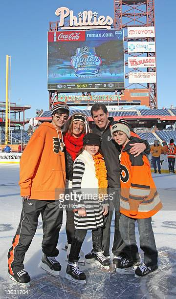 Head coach of the Philadelphia Flyers Peter Laviolette and his family pose for a picture after the teams practice session at the 2012 Winter Classic...