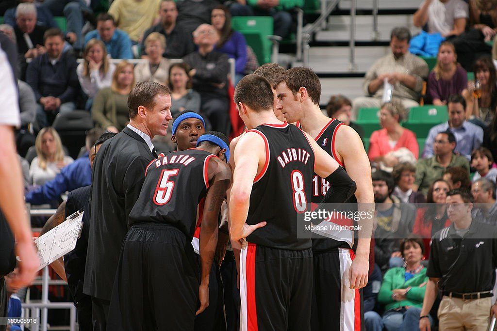 Head Coach of the Portland Trail Blazers, <a gi-track='captionPersonalityLinkClicked' href=/galleries/search?phrase=Terry+Stotts&family=editorial&specificpeople=653534 ng-click='$event.stopPropagation()'>Terry Stotts</a> meets with players during a timeout against the Utah Jazz at Energy Solutions Arena on February 01, 2013 in Salt Lake City, Utah.