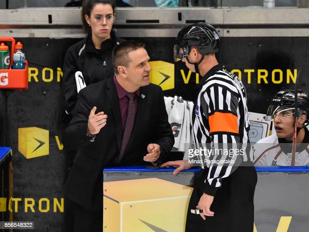 Head coach of the RouynNoranda Huskies Gilles Bouchard speaks with the referee against the BlainvilleBoisbriand Armada during the QMJHL game at...