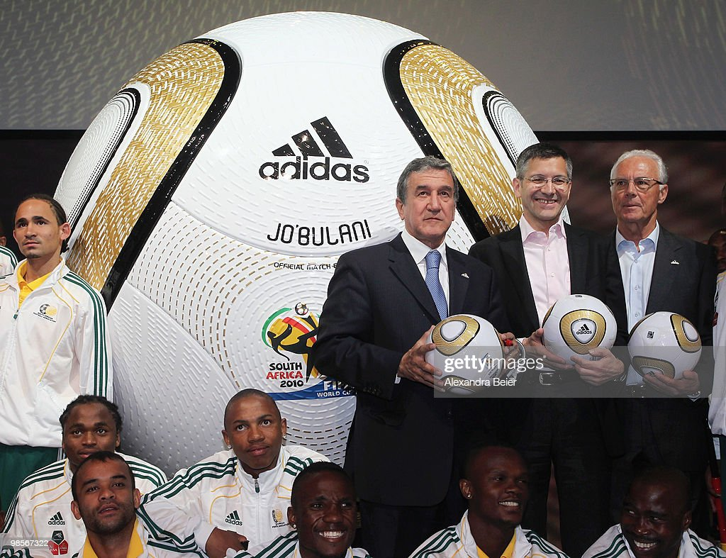 Head coach of the South African national soccer team Carlos Alberto Parreira, Adidas CEO Herbert Hainer and German soccer legend Franz Beckenbauer (L-R) and the South African national soccer team present the FIFA World Cup 2010 final match ball on April 20, 2010 in Herzogenaurach, Germany.