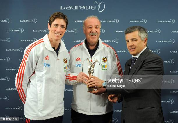 Head coach of the Spanish team Vicente del Bosque and player Fernando Torres receive the Laureus Team award from the president of Laureus Foundation...