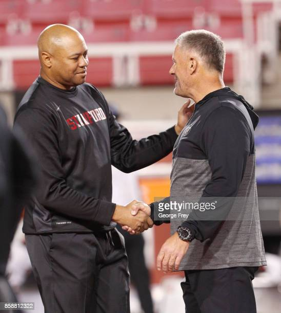 Head coach of the Stanford Cardinal David Shaw left and Utah Utes head coach Kyle Whittingham shake hands before an college football game on October...