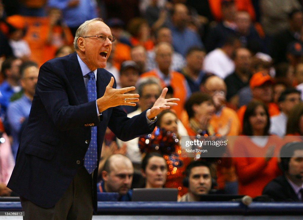 Head coach of the Syracuse Orange, <a gi-track='captionPersonalityLinkClicked' href=/galleries/search?phrase=Jim+Boeheim&family=editorial&specificpeople=210990 ng-click='$event.stopPropagation()'>Jim Boeheim</a> gestures as he yells to players on the court during the game against the Eastern Michigan Eagles at the Carrier Dome on November 29, 2011 in Syracuse, New York.