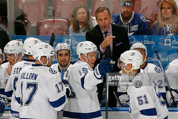 Head Coach of the Tampa Bay Lightning Jon Cooper directs his team from the bench during a break in the action against the Florida Panthers at the BBT...