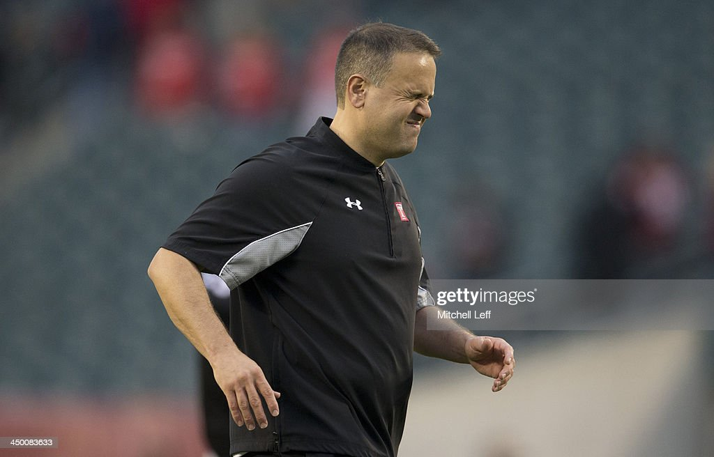 Head coach of the Temple University Owls Matt Rhule walks off the field after the defeat to the University of Central Florida Knights catches a pass against the Temple University Owls on November 16, 2013 at Lincoln Financial Field in Philadelphia, Pennsylvania.