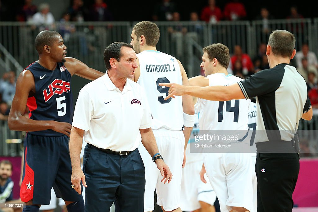 Head coach of the United States <a gi-track='captionPersonalityLinkClicked' href=/galleries/search?phrase=Mike+Krzyzewski&family=editorial&specificpeople=213322 ng-click='$event.stopPropagation()'>Mike Krzyzewski</a> reacts during an altercation between team United States and Argentina during the Men's Basketball Preliminary Round match against Argentina on Day 10 of the London 2012 Olympic Games at the Basketball Arena on August 6, 2012 in London, England.