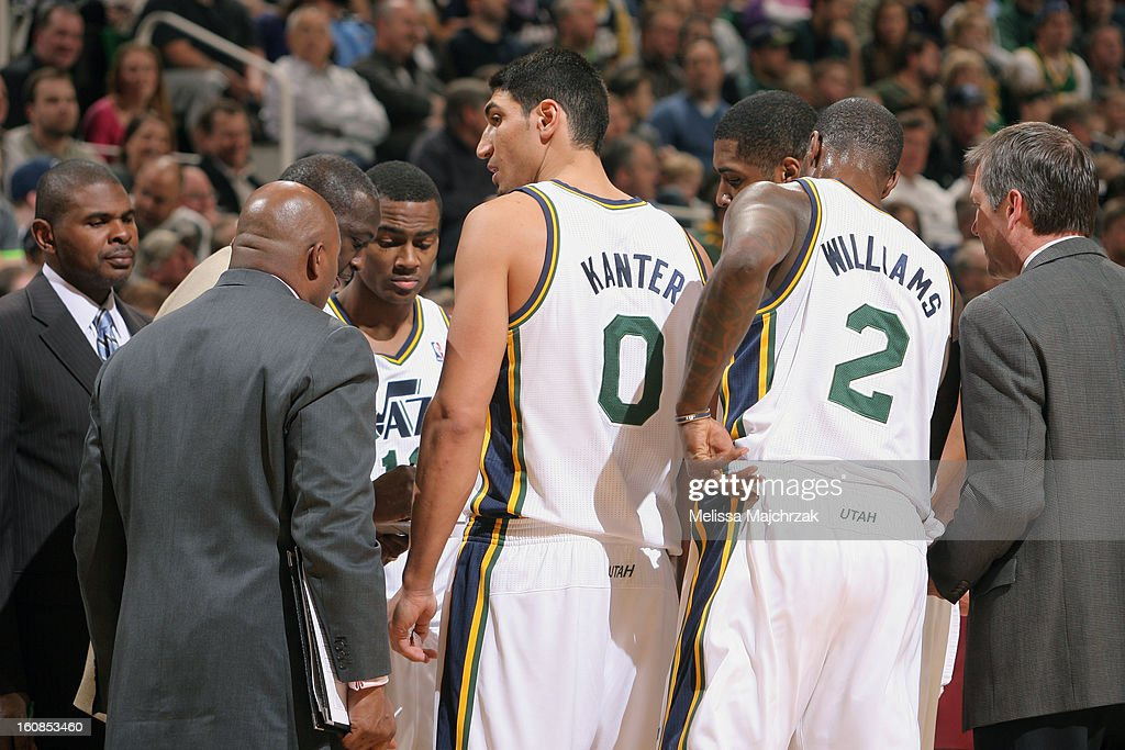 Head Coach of the Utah Jazz, Tyrone Corbin develops plays with players during a timeout against the Milwaukee Bucks at Energy Solutions Arena on February 06, 2013 in Salt Lake City, Utah.