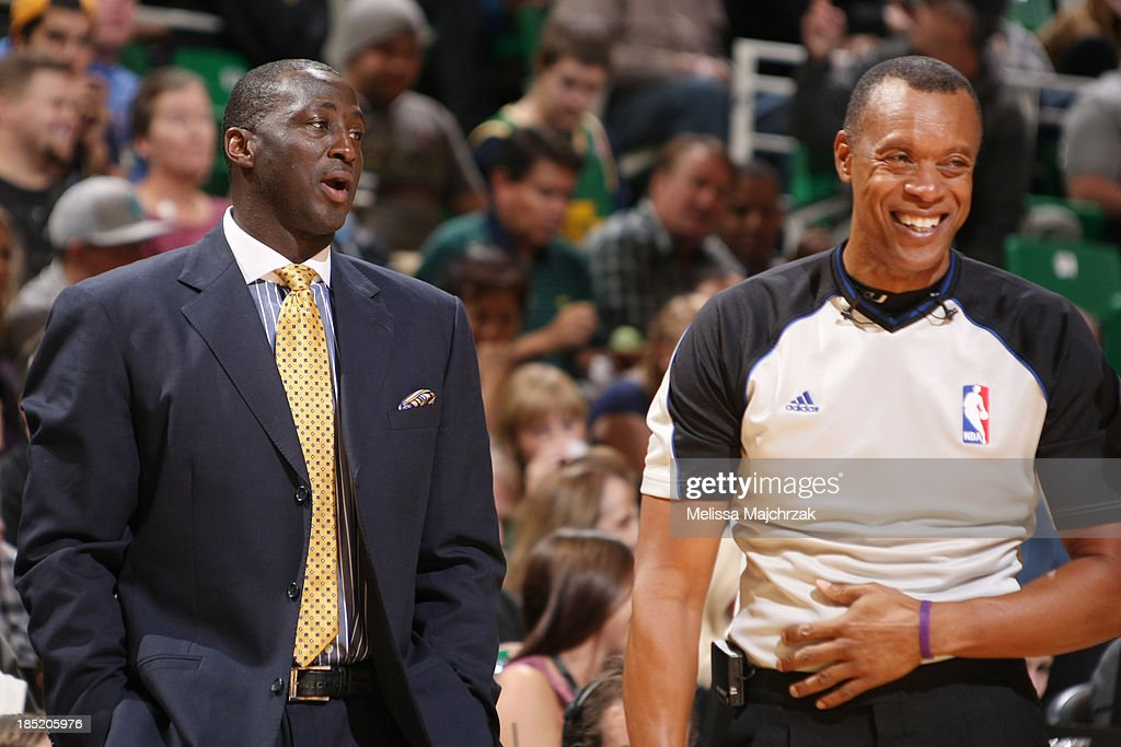 Head Coach of the Utah Jazz, <a gi-track='captionPersonalityLinkClicked' href=/galleries/search?phrase=Tyrone+Corbin&family=editorial&specificpeople=829288 ng-click='$event.stopPropagation()'>Tyrone Corbin</a> jokes with referee Rodney Mott during play against the Portland Trail Blazers at Energy Solutions Arena on October 16, 2013 in Salt Lake City, Utah.