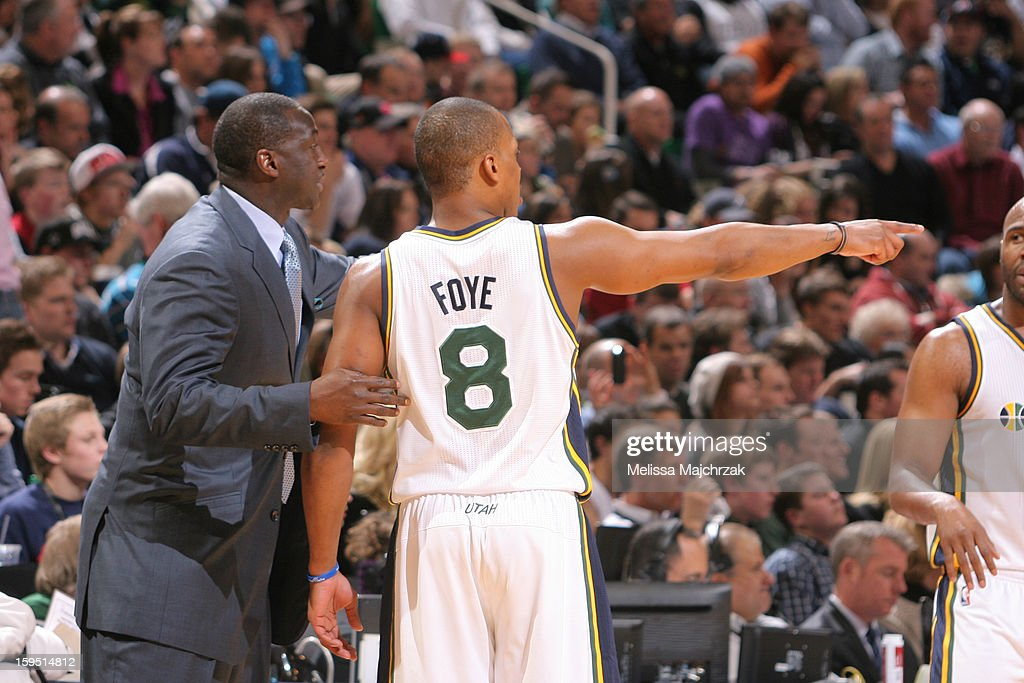 Head Coach of the Utah Jazz Tyrone Corbin talks with player Randy Foye #8 during a break in play against the Miami Heat at Energy Solutions Arena on January 14, 2013 in Salt Lake City, Utah.