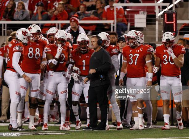 Head coach of the Utah Utes Kyle Whittingham talk to his players during the first half of an college football game against the Stanford Cardinal on...