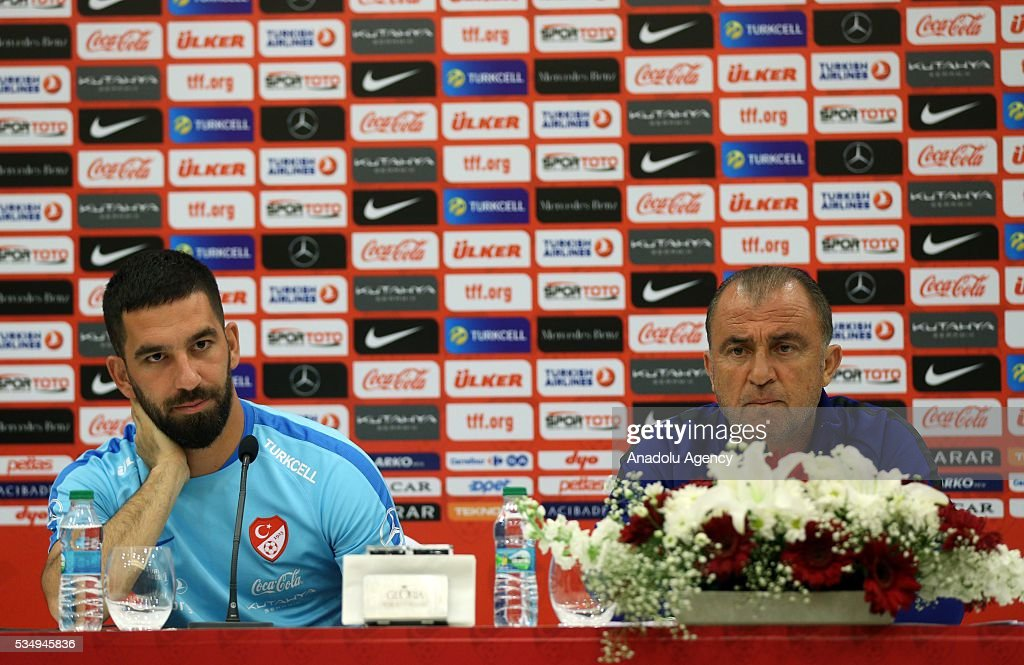 Head coach of Turkey's national football team Fatih Terim (R) and Arda Turan (L) hold a media conference at the Gloria Serenity Resort in Belek district of Turkey's Antalya province on May 28, 2016, ahead of a friendly game against Montenegro which will be played on May 29, 2016, at the Antalya Arena, as part of their Euro 2016 preparations.