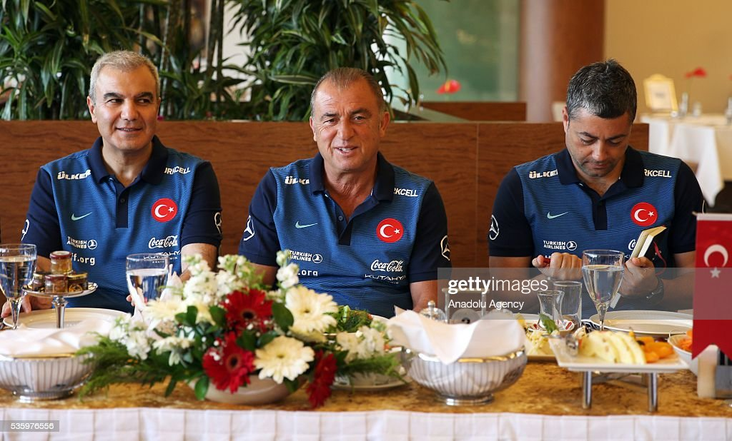 Head coach of Turkey's national football team, Fatih Terim (C) makes statements to the media during a breakfast as Turkey's national football team continues training at Gloria Sports Arena ahead of UEFA Euro 2016, in Antalya, Turkey on May 31, 2016.