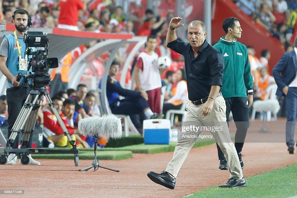Head coach of Turkey's national football team Fatih Terim (C) reacts during the friendly football match between Turkey and Montenegro at Antalya Ataturk Stadium in Antalya, Turkey on May 29, 2016.