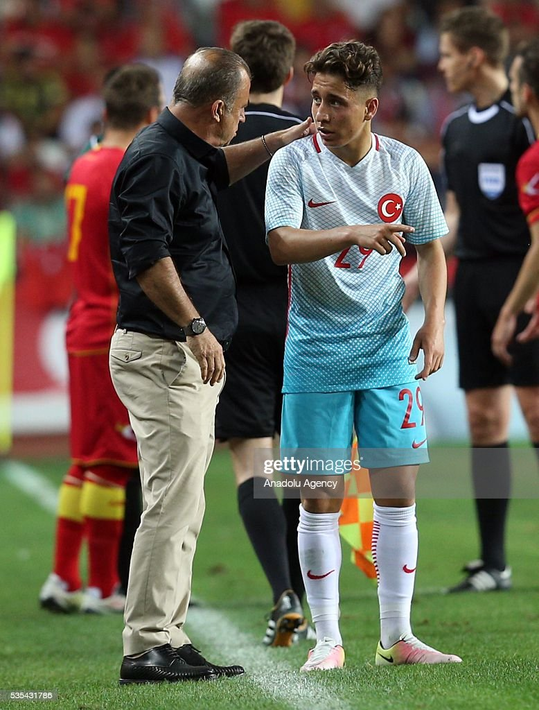 Head coach of Turkey's national football team Fatih Terim (L) speaks to Emre Mor (R) of Turkey during the friendly football match between Turkey and Montenegro at Antalya Ataturk Stadium in Antalya, Turkey on May 29, 2016.