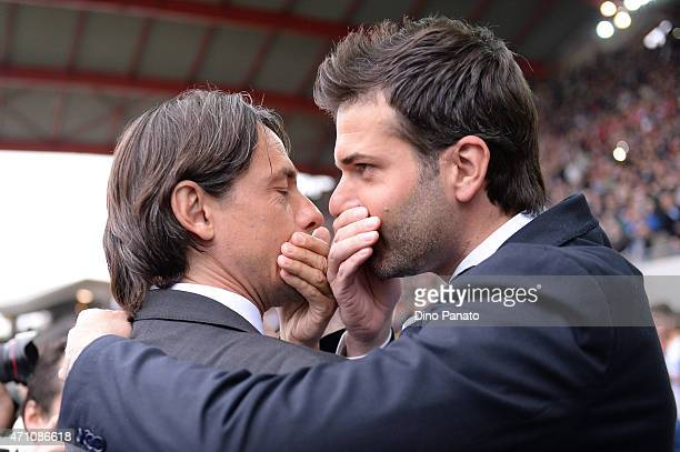 Head coach of Udinese Andrea Stramaccioni has a discussion with Head coach of AC Milan Filippo Inzaghi during the Serie A match between Udinese...