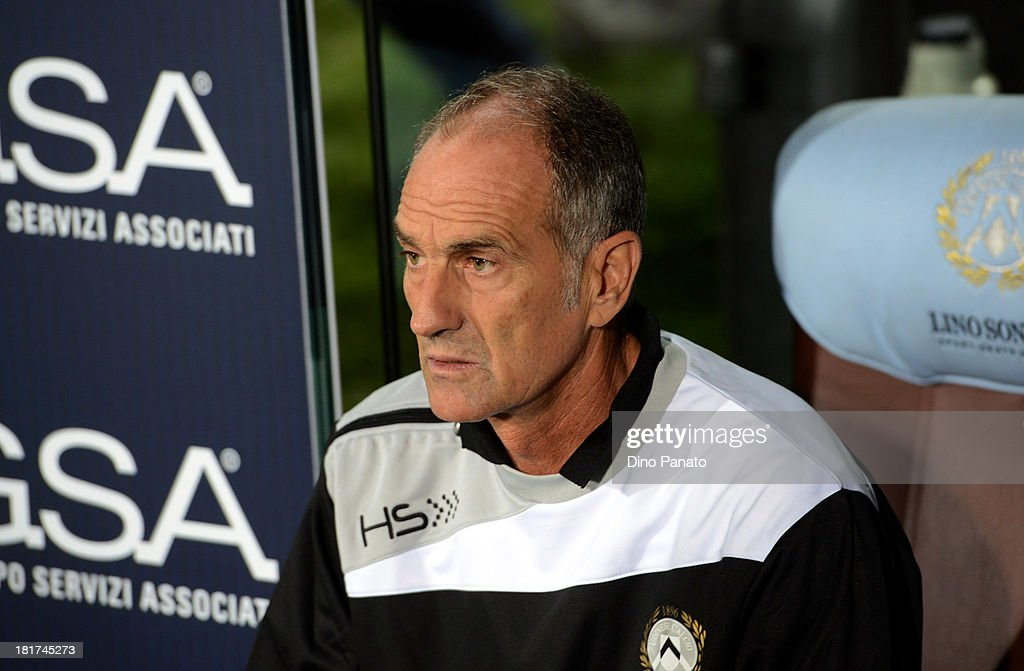 Head coach of Udinese Calcio <a gi-track='captionPersonalityLinkClicked' href=/galleries/search?phrase=Francesco+Guidolin&family=editorial&specificpeople=770478 ng-click='$event.stopPropagation()'>Francesco Guidolin</a> drinks during the Serie A match between Udinese Calcio and Genoa CFC at Stadio Friuli on September 24, 2013 in Udine, Italy.