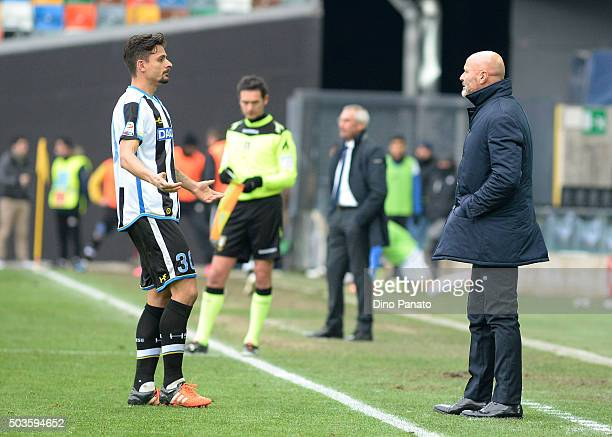Head coach of Udinese Stefano Colantuono speaks with Felipe Dal Bello during the Serie A match between Udinese Calcio v Atalanta BC at Stadio Friuli...