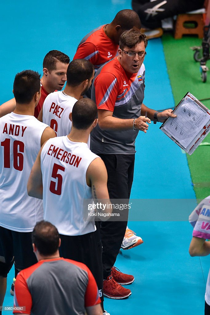 Head coach of Venezuela Vincenzo Nacci gives advice to his players during the Men's World Olympic Qualification game between Venezuela and Canada at Tokyo Metropolitan Gymnasium on June 1, 2016 in Tokyo, Japan.
