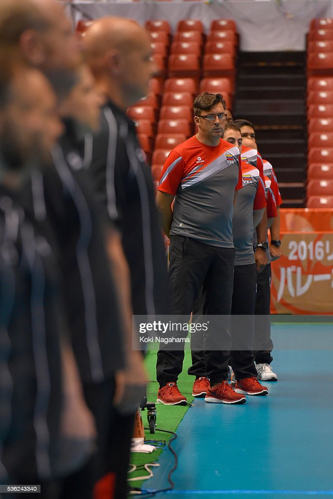 Head coach of Venezuela Vincenzo Nacci lines up for his national anthem prior to the Men's World Olympic Qualification game between Venezuela and Canada at Tokyo Metropolitan Gymnasium on June 1, 2016 in Tokyo, Japan.