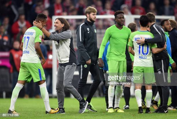 Head coach of Wolfsburg Martin Schmidt celebrates the 22 draw with his team after the German Bundesliga soccer match between FC Bayern Munich and VfL...