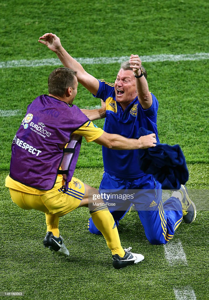 Head Coach <a gi-track='captionPersonalityLinkClicked' href=/galleries/search?phrase=Oleh+Blokhin&family=editorial&specificpeople=2924837 ng-click='$event.stopPropagation()'>Oleh Blokhin</a> of Ukraine celebrates victory <a gi-track='captionPersonalityLinkClicked' href=/galleries/search?phrase=Andriy+Shevchenko&family=editorial&specificpeople=220501 ng-click='$event.stopPropagation()'>Andriy Shevchenko</a> of Ukraine during the UEFA EURO 2012 group D match between Ukraine and Sweden at The Olympic Stadium on June 11, 2012 in Kiev, Ukraine.