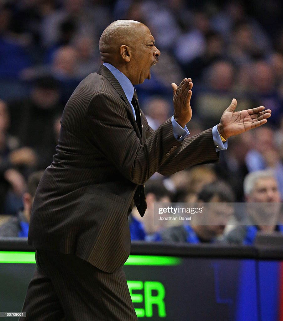 Head coach Oliver Purnell of the DePaul Blue Demons encourages his team against the Georgetown Hoyas at the Allstate Arena on February 3, 2014 in Rosemont, Illinois. Georgetown defeated DePaul 71-59.