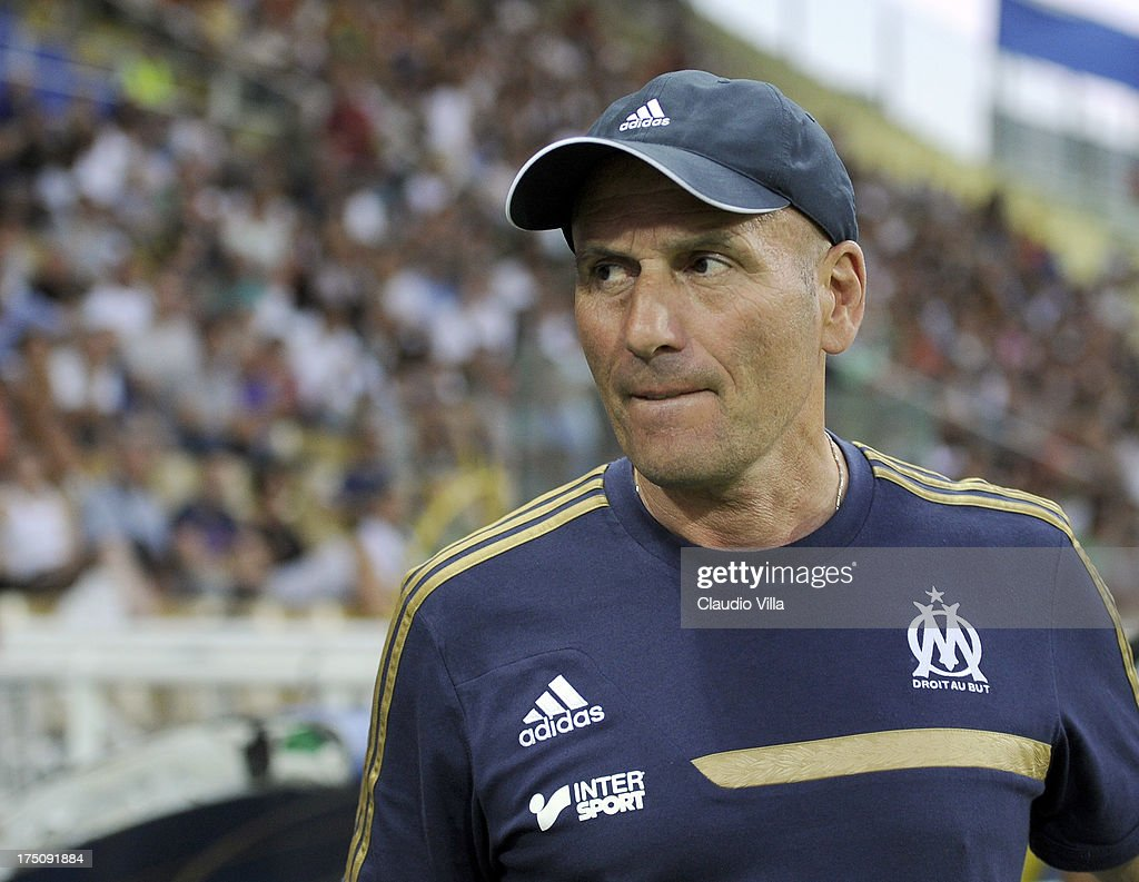 Head coach Olympique de Marseille <a gi-track='captionPersonalityLinkClicked' href=/galleries/search?phrase=Elie+Baup&family=editorial&specificpeople=536928 ng-click='$event.stopPropagation()'>Elie Baup</a> during the pre-season friendly match between Parma FC and Olympique Marseille at Stadio Ennio Tardini on July 31, 2013 in Parma, Italy.