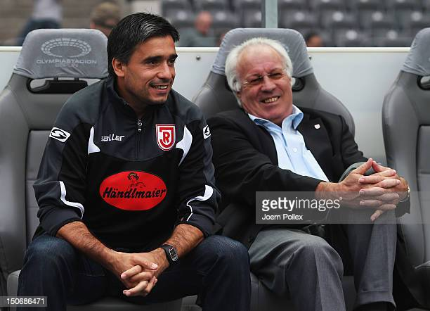 Head coach Oscar Corrochano and teammanager Klaus Sturm of Regensburg smile prior to the Second Bundesliga match between Hertha BSC Berlin and Jahn...