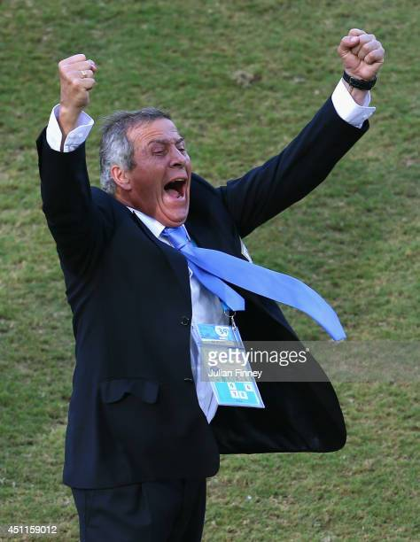 Head coach Oscar Tabarez of Uruguay celebrates victory in the 2014 FIFA World Cup Brazil Group D match between Italy and Uruguay at Estadio das Dunas...