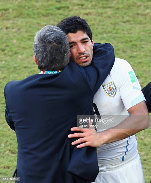 Head coach Oscar Tabarez of Uruguay hugs Luis Suarez after a 10 victory over Italy during the 2014 FIFA World Cup Brazil Group D match between Italy...