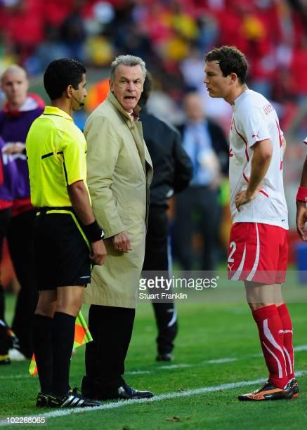 Head coach Ottmar Hitzfeld and Stephan Lichtsteiner of Switzerland appeal to the referee's assistant Hassan Kamranifar after referee Khalil Al Ghamdi...