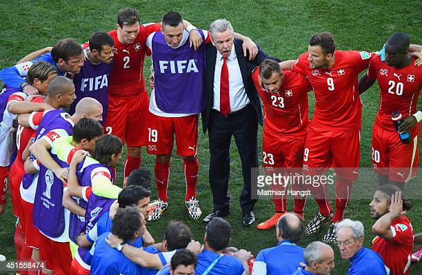 Head coach Ottmar Hitzfeld of Switzerland speaks to his players in a huddle prior to the start of extra time during the 2014 FIFA World Cup Brazil...