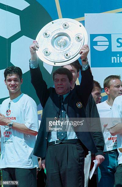 Head coach Otto Rehhagel and Michael Ballack of Kaiserslautern celebrate with the trophy after winning the German Championship during the Champions...