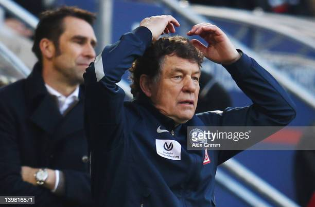 Head coach Otto Rehhagel assistant coach Rene Tretschok and manager Michael Preetz of Berlin react during the Bundesliga match between FC Augsburg...