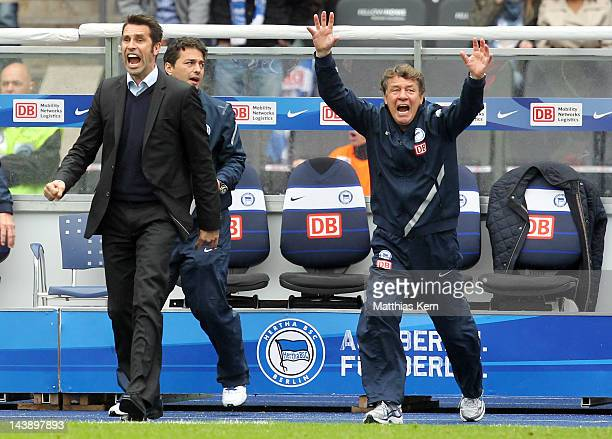 Head coach Otto Rehhagel of Berlin and manager Michael Preetz react during the Bundesliga match between Hertha BSC Berlin and TSG 1899 Hoffenheim at...