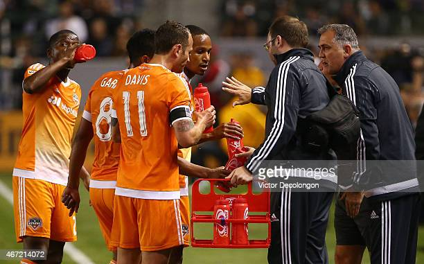 Head Coach Owen Coyle of the Houston Dynamo talks to his players during a break in play in the first half of the MLS match against the Los Angeles...