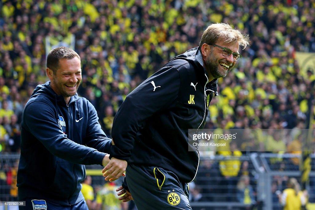 Head coach Pal Dardai of Berlin and head coach Juergen Klopp of Dortmund joke prior to the Bundesliga match between Borussia Dortmund and Hertha BSC...