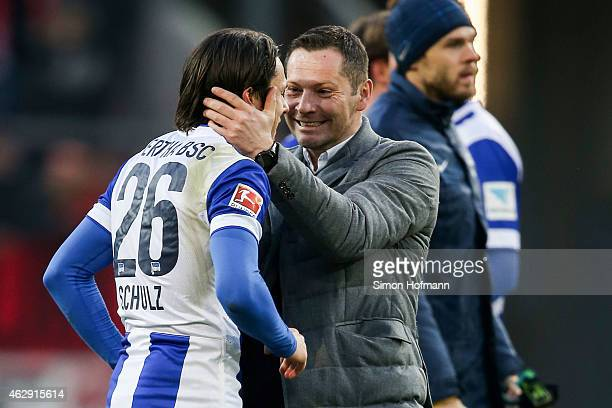 Head coach Pal Dardai of Berlin celebrates winning with Nico Schulz after the Bundesliga match between 1 FSV Mainz 05 and Hertha BSC at Coface Arena...