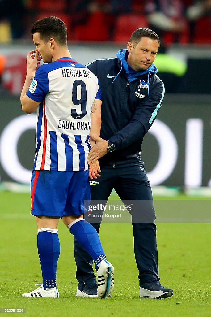 Head coach <a gi-track='captionPersonalityLinkClicked' href=/galleries/search?phrase=Pal+Dardai&family=editorial&specificpeople=604310 ng-click='$event.stopPropagation()'>Pal Dardai</a> of Berlin comforts <a gi-track='captionPersonalityLinkClicked' href=/galleries/search?phrase=Alexander+Baumjohann&family=editorial&specificpeople=764148 ng-click='$event.stopPropagation()'>Alexander Baumjohann</a> of Berlin after the Bundesliga match between Bayer Leverkusen and Hertha BSC Berlin at BayArena on April 30, 2016 in Leverkusen, Germany. The match between Leverkusen and Belrin ended 2-1.