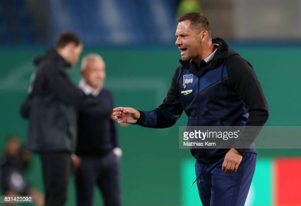 Head coach Pal Dardai of Berlin gestures during the DFB Cup first round match between FC Hansa Rostock and Hertha BSC at Ostseestadion on August 14...